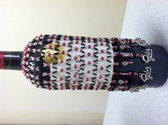 Beaded wine bottle cover with Party charms