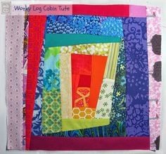 The Rainbow Scrapbusting Wonky Quilt Block is a fun, bright way to get a little playful with your quilting. This scrappy quilt block pattern is reminiscent of a log cabin quilt block.