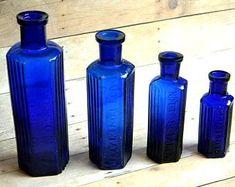 Skull And Bones Vintage Poison Bottle Shaped Like a Coffin. Vintage Bottle Design From Glass Manufacturer Wheaton Industries. Antique Bottles, Vintage Bottles, Antique Glassware, Small Bottles, Bottles And Jars, Glass Bottles, Cobalt Glass, Cobalt Blue, Antique Shelves