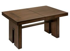 Whether it's style or versatility you prioritize in dining room furniture, the Teagan dining table is an excellent choice. The rich walnut veneers lend a stunning, warm look that will beautify any space, while the block-style legs provide a bold statement. Plus, a self-storing leaf gives you room for extra guests.