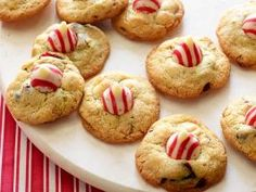 Macadamia-Almond Christmas Cookies : Nancy Fuller folds in the white chocolate chips, pistachios and cranberries into her macadamia nut cookie dough for buttery cookies that have just the right amount of crunch. Press a red and white striped kiss into the center of each cookie right after they come out of the oven and are still warm.