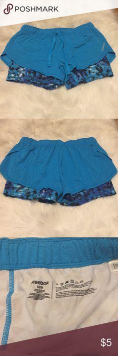 Reebok running shorts Reebok running shorts with spandex shorts under! Never worn! Size medium! Reebok Shorts
