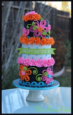 Bright and Bold Quilling! - I had a lot of fun with this cake.. Using black as the base and the neon colors really made the quilling flowers pop. My client sent me another cake pic to use as inspiration and this is what I came up with. Thanks for looking!