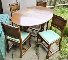 Vintage Wooden Oval Drop Leaf Dining Table and 4 Chairs in a Very Good Condition