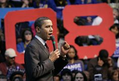 Democratic presidential Sen. Barack Obama, D-Ill., speaks at a rally at Lander University as supporters hold up large cardboard numbers that spell '08' in Greenwood, S.C.