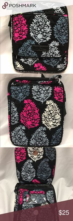 Vera Bradley Northern Lights Mini Hipster NWT The Mini Hipster has a front flap with zippered pocket and a clear id window. The exterior has a slip in pocket. The interior has 6 card slots. It's finished with a zippered closure. This is from a smoke free home! Vera Bradley Bags Crossbody Bags