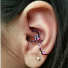 A snazzy daith piercing with a gem cluster by @ANATOMETAL, with a matching conch ring! By Jared of [Born This Way Body Arts - Knoxville, TN]...