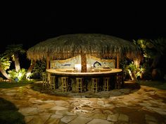 Backyard tiki bar with 12 foot palapa umbrella roof at nightCall Toll Free: 1(888)788-2254