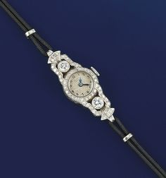 A lady's white gold and diamond wristwatch  The circular dial with Arabic numerals to single-cut diamond surround and shaped openwork shoulders with brilliant-cut diamond collet accent and cordette straps, circa 1935