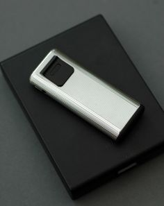 A Braun 'dymatic' pocket lighter, designed by Dieter Rams in 1980.  // I GOT ONE OF THESE TODAY! the valve leaks but i think it's probably fixable.