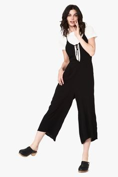Our Freya jumpsuit features thin straps that cross in the back and come around to a unique crossed keyhole tie in the front. She has an elastic waist and flowy