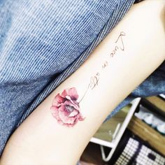 No clue what that says, but its so pretty! Delicate. #flower #delicate #script #quotetattoo