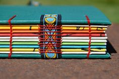 colorful coptic stitch binding over tapes {turquesa multicolor} | . . . e n s o ñ a c i ó n . . .