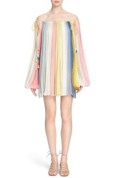 Free shipping and returns on Chloé Pleated Dip Dye Off the Shoulder Dress at Nordstrom.com. Dip-dyed rainbow hues softly stripe this crinkled-silk shift, imbuing the style with a playful spirit that stays true to Chloé's poetic femininity. Delicate pleating gives easy airiness to the billowy bishop sleeves and flowy silhouette, as tassel-tipped ties relax the neckline to expose the shoulders.
