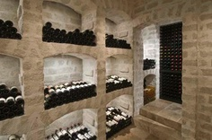What is this stone or brick-symmetrical-house-wine-room Wine Shelves, Wine Storage, Caves, Houston Architecture, Wine Cellar Basement, Home Wine Cellars, Bar A Vin, Wine Cellar Design, Wine Glass Rack