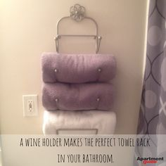 Apartment Hacks: Use a wine holder as a towel rack -- :) will be looking for a thrifted wine rack! huzzah!