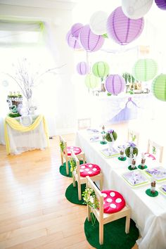 Dreamy Lavender Woodland Fairy Party- I just really love the mushroom cushions and the grass under the chairs. Simple, but totally ties the theme together. I think if I were a little girl I would love sitting on one of those tuffets!!! #auntiesocial