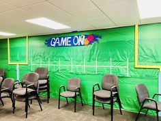 VBS 2018- Lifeway- Game On Decorations- Football goal post made from styrofoam insulation purchased from Lowe's- painted and cut with a heat knife. Hanging on wall with painter's tape $3