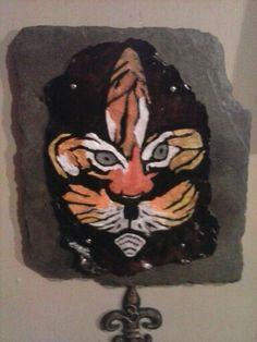 Tiger fleuridelis polymete clay on slate.