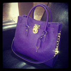 Michael Kors. loving this color! I have this bag in grey snakeskin, but this purple is FAB!