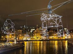 Ghent Light Festival, GLF 29.01 01.02.215 Belgium 40. Ralf Westerhof - Drawn in light Muinkkaai  An ever-changing cityscape, drawn in light, shimmers in the dark air. Enjoy its ever-changing minimal lines.