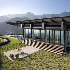 Gorgeous views of the Santa Ynez Mountains are provided by this glass-walled Montecito home. As wildfires often ravage this part of the Santa Barbara coast, the architects chose fire-resistant materials (steel, concrete) for the construction.