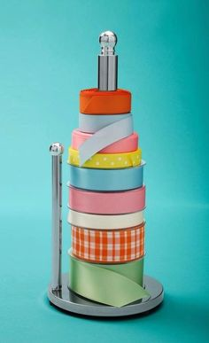 Use a paper towel holder to keep your spools of ribbon organized and easy to get to. I like this idea because you can keep it out on a craft... Ribbon Organization, Ribbon Storage, Organization Station, Organization Hacks, Gift Wrap Storage, Household Organization, Wrapping Gifts, Wrapping Paper Storage, Paper Towel Storage