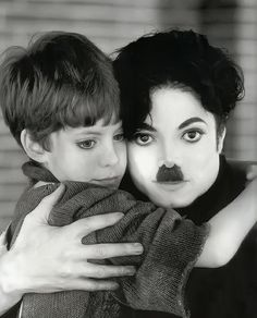 Michael Jackson dressed as Charlie Chaplin.  Not sure who the little boy is, if anyone knows, please let me know.