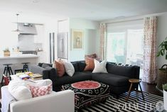 living rooms - grey couch grey sofa dark sofa dark couch stripped rug hipster  Amber Lewis' Living Room featured on So Haute