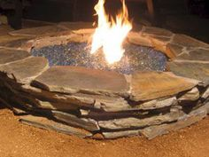 Outdoor fire pit ideas using fire glass. Modern outdooor fireplace designs using burning glass. Love the use of flat stone to build pit Fire Pit Ring, Diy Fire Pit, Fire Pit Backyard, Backyard Bbq, Fire Pits, Backyard Ideas, Firepit Ideas, Backyard Designs, Modern Backyard