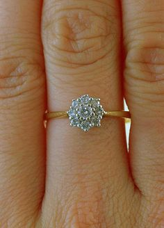 ATTENTION THIS IS THE ONE I WAANNNTTT  Vintage 1930s Diamond Flower Engagement Ring in 18k Gold and Platinum, via Etsy.