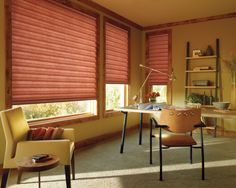 The beauty of Solera™ Soft Shades adds softness and convenience to a home office.  ♦ Hunter Douglas window treatments