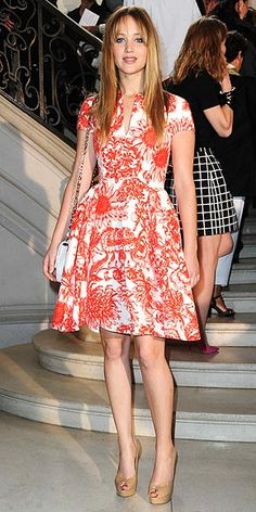 JENNIFER LAWRENCE in a bold floral print dress and nude pumps (both by Dior, plus a Miss Dior bag) at the Dior Haute Couture show in Paris.