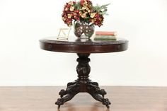 A round lamp or hall center table has an 1830's base, hand carved of mahogany with lion paw feet and an acanthus column. The matched walnut rebuilt