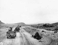 A U.S. reconnaissance party in Jeeps re-enters Kasserine Pass along the Kasserine-Thala road. Rommel pushed his forces up this road during his attack through the pass.