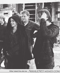 Rupert and Emma watching the playback of the kiss footage