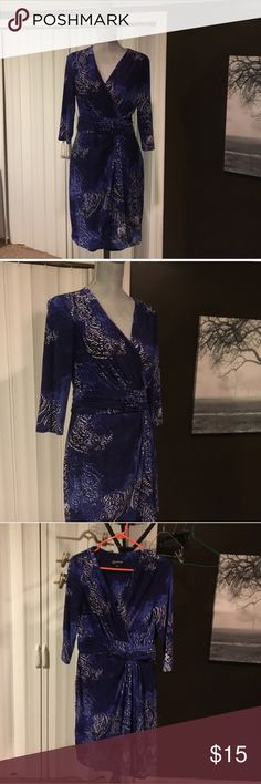 Jones New York Faux Wrap Dress size 8 Like new condition. This dress is a beautiful blue, purple and white print. Touching at waist for a faux wrap look. Didn't fit me quite right so I'm re-poshing. Jones New York Dresses Long Sleeve