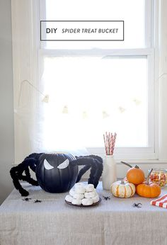 A foam pumpkin and oversized pipe cleaners combine to make a giant spider bucket—perfect for storing candy—in just a few quick steps.