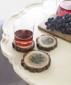 To make these rustic drink perches, you'll need a tree limb that's roughly three inches in diameter. (Save-on-crafts.com sells birch logs for $12.29 a foot.) Saw the branch into slices about3/4-inch thick—or have a hardware store do it for you—and lightly sand each wood disk. Create the leaf motifs shown by pressing an inked stamp (stamps, $23.28 a set; green ink pad, $6.61; stampinup.com) onto each coaster. Let dry for five minutes, then coat the stamped side with a protective matte…