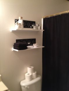 Super proud of myself. Just hung some shelves in our bathroom.