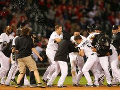 CELEBRATE GOOD TIMES: Baseball's Walk-Off Wins - May 18 - White Sox second baseman Carlos Sanchez is mobbed by teammates after hitting a walk-off single against the Indians at U.S Cellular Field.  -    © Caylor Arnold, USA TODAY Sports