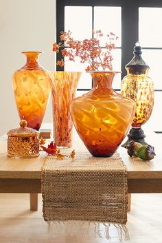 Turn mantels, desks and side tables into galleries with Pier stunning artisan glass vases and jars. Each is handcrafted with curvy silhouettes and rich fall hues. Fill with dried florals, or let them stand alone as the museum-worthy pieces they are. Fall Home Decor, Autumn Home, Home Decor Lights, Harvest Decorations, Autumn Decorating, Fall Scents, Vase Centerpieces, Home And Deco, Fall Harvest
