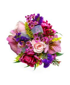 MIXED GARDEN CORSAGE - Two pink sweetheart roses, two pink alstromeria, two scarlet king mini carnations, purple statice, pink waxflower and solidago. Designed as a wrist corsage, but can be converted to a pin on corsage with included pins. Item #596.