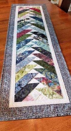 Quilted table runners patterns - Quilted Table Runner, Scrappy Batik Braid with flying geese in Blues, Greens, Aquas, Creams and a to – Quilted table runners patterns Star Quilts, Scrappy Quilts, Mini Quilts, Colchas Quilting, Quilting Projects, Machine Quilting, Table Runner And Placemats, Quilted Table Runners, Quilted Table Runner Patterns