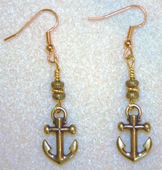 Handcrafted by Teal Palmetto, LLC. These golden ship anchor earrings were purchased by a customer in Beaufort, South Carolina.