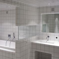 If you must have tiles in your bathroom, then go over the top!
