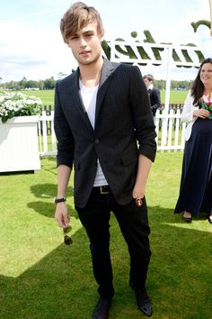 Actor Douglas Booth...also that lady in the back creepin