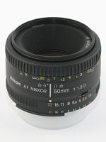 Nikon Nikkor AF 50 mm f/1.8D.  Cheap lens i would recommend to everyone.