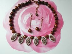 This  necklace- earrings  set  features  18 mm x 8 mm  Chohua  jasper  beads,  12  mm  brown  obsidian  beads,  goldtone  spacers  and  NOS  spacer  rondelles.  I  found  this  vendor   who  sells  on