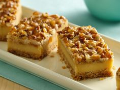 Praline Crumb Caramel Cheesecake Bars. One of my favorite ways to eat cheesecake! So delicious!!